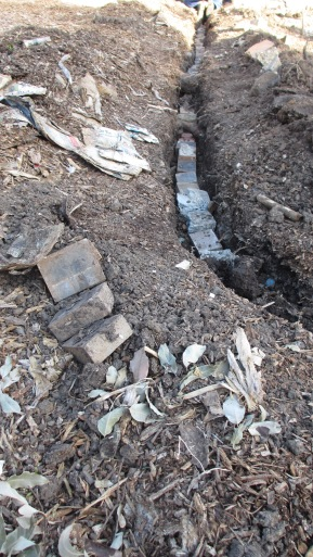 Trench for irrigation pipe